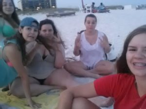 "This picture is from a trip to Orange Beach that I took with Brooke, Lauryn, Megan and Stacey. We listened to ""Irreplaceable"" by Beyonce. That song still reminds me of that time 6 years later! Melanie, cousin"