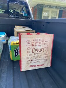 Children's clothing, red beans & rice, seasoning, paper towels, cleaning supplies, insect repellant and work gloves all packed up and ready to go.